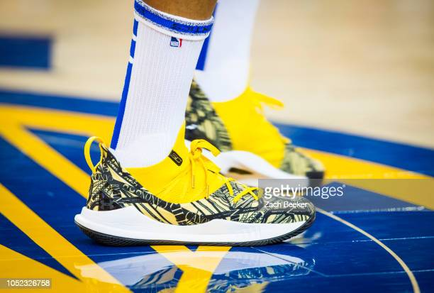 the sneakers of Stephen Curry of the Golden State Warriors are seen against the Oklahoma City Thunder on October 16 2018 at ORACLE Arena in Oakland...