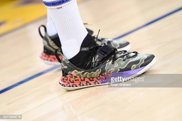 the sneakers of Stephen Curry of the Golden State Warriors are seen against the Minnesota Timberwolves on December 10 2018 at ORACLE Arena in Oakland...