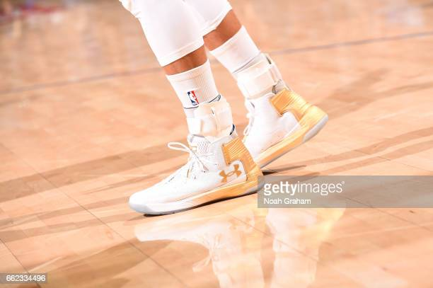 The sneakers of Stephen Curry of the Golden State Warriors are seen during a game against the Houston Rockets on March 31 2017 at ORACLE Arena in...