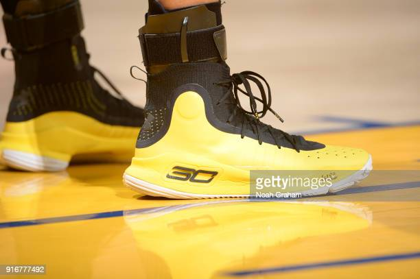 9705a4d8 The sneakers of Stephen Curry of the Golden State Warriors are seen during  the game against