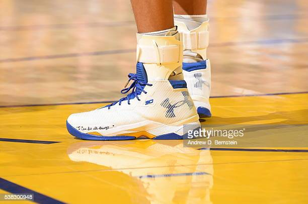 The sneakers of Stephen Curry of the Golden State Warriors during the game against the Cleveland Cavaliers in Game Two of the 2016 NBA Finals on June...