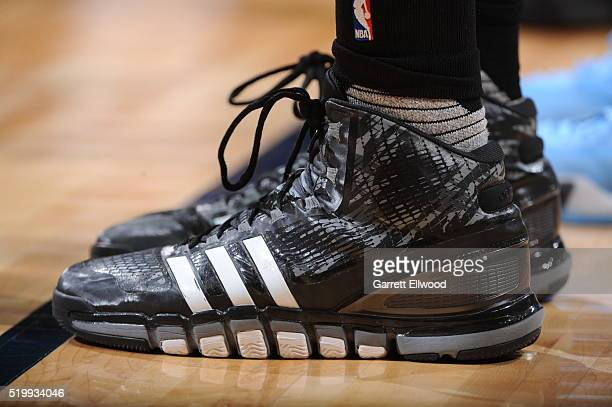 The sneakers of Tim Duncan of the San Antonio Spurs during the game against the Denver Nuggets on April 8 2016 at the Pepsi Center in Denver Colorado...