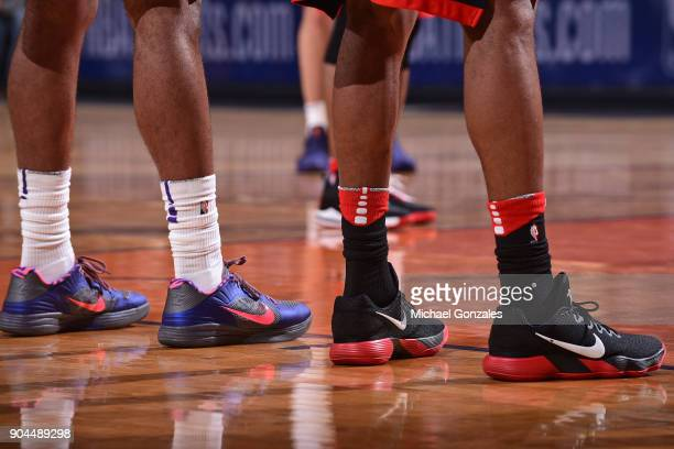 The sneakers of TJ Warren of the Phoenix Suns and Trevor Ariza of the Houston Rockets during the game on January 12 2018 at Talking Stick Resort...
