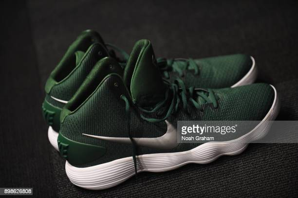 The sneakers of Zaza Pachulia of the Golden State Warriors are displayed in the locker room before the game against the Cleveland Cavaliers on...