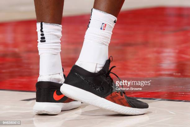 the sneakers worn by AlFarouq Aminu of the Portland Trail Blazers are seen against the New Orleans Pelicans in game one of round one of the 2018 NBA...
