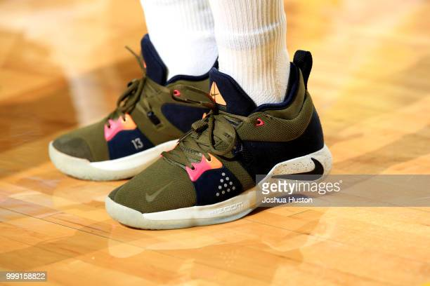 The sneakers worn by Alysha Clark of the Seattle Storm during the game against the Dallas Wings on July 14 2018 at Key Arena in Seattle Washington...