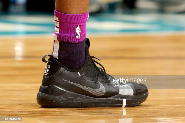 The sneakers worn by Andrew Wiggins of the Minnesota Timberwolves during the game against the Charlotte Hornets on March 21 2019 at Spectrum Center...