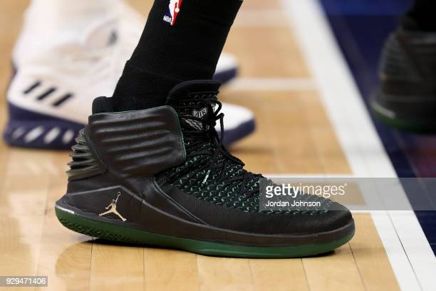 the sneakers worn by Greg Monroe of the Boston Celtics are seen during the game against the Minnesota Timberwolves on March 8 2018 at Target Center...