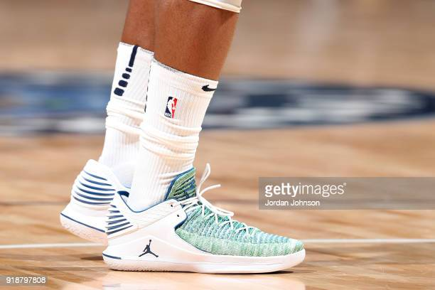 the sneakers worn by Jimmy Butler of the Minnesota Timberwolves are seen during the game against the Los Angeles Lakers on February 15 2018 at Target...