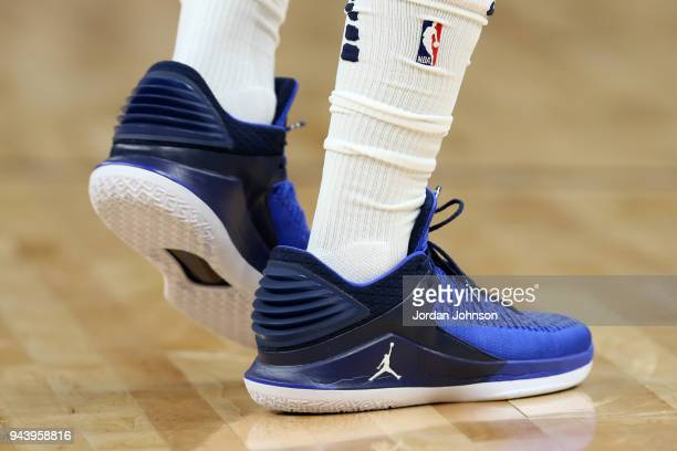 the sneakers worn by Jimmy Butler of the Minnesota Timberwolves are seen during the game against the Memphis Grizzlies on April 9 2018 at Target...