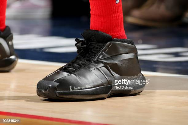 the sneakers worn by Kelly Oubre Jr #12 of the Washington Wizards are seen during the game against the Milwaukee Bucks on January 15 2018 at Capital...