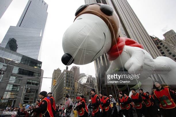 The Snoopy balloon makes its way through Columbus Circle during the 80th Macy's Thanksgiving Day parade November 23 2006 in New York City Due to the...