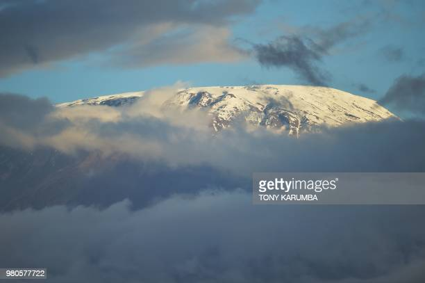 The snow covered peak of Mt Kilimanjaro is seen from the Amboseli National Park June 21 2018 Amboseli is among the most renowned case studies in the...