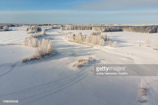 the snow on the river ice is decorated with snow mobile tracks. - heinovirta stock pictures, royalty-free photos & images
