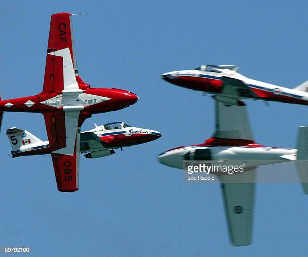 The Snowbirds a Canadian forces air demonstration team fly together May 1 2004 during a performance at the 2004 McDonald's Air and Sea Show in Fort...