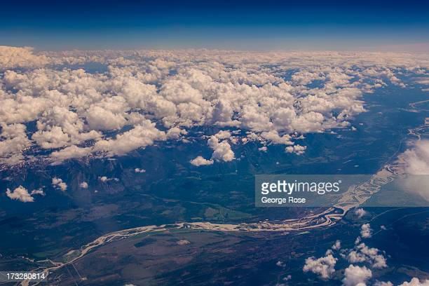 The snowcapped Canadian Rocky Mountains and Bow River are viewed from 30000 feet on June 24 2013 in Lake Louise Alberta Canada Major flooding along...