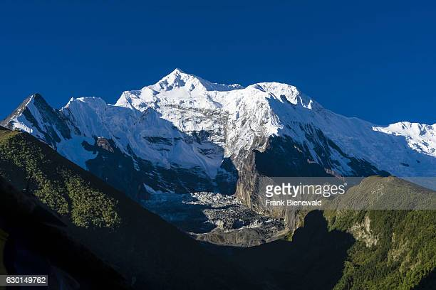 The snowcapped mountain Annapurna 2 is rising above the Upper Marsyangdi valley