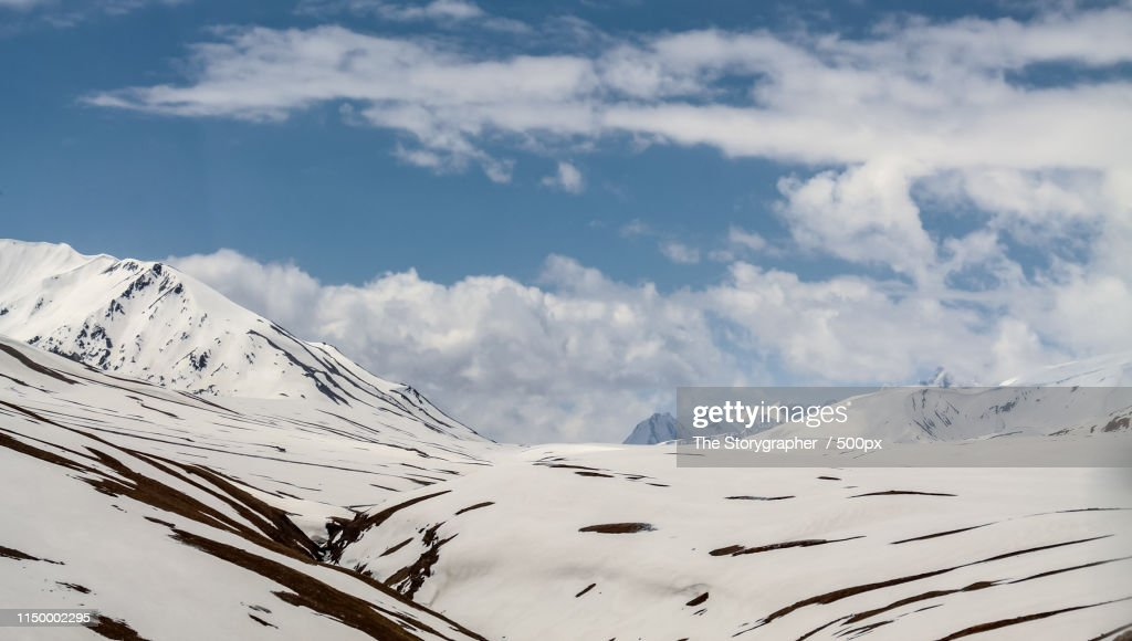 The Snowcapped Mountains Touching The Clouds : Stock Photo