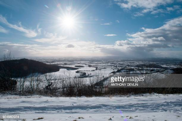 The snowcovered fields and hills of Thirsk are seen at Sutton bank National Park Centre in the North Yorks Moors National Park in North Yorkshire on...
