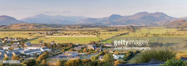 the snowdon mountain range viewed from harlech, gwynedd, wales. - gwynedd stock photos and pictures