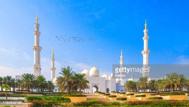 the snow-white imposing sheikh zayed mosque in abu dhabi - palace stock pictures, royalty-free photos & images