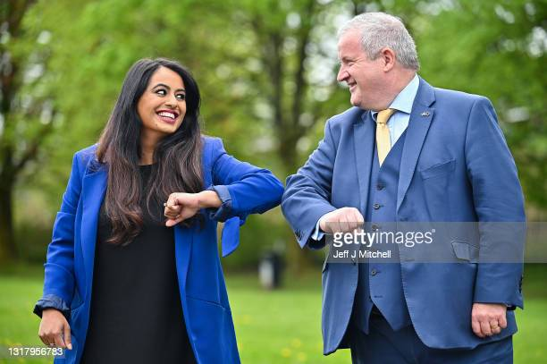 The SNP's Anum Qaisar-Javed and Ian Blackford pose for a photograph at West End Park on May 14, 2021 in Airdrie, Scotland. The SNP has held its...
