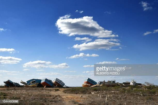 The socalled boat cemetery where skiffs are dumped after the migrants and refugees' crossing from North Africa is pictured in Lampedusa on September...