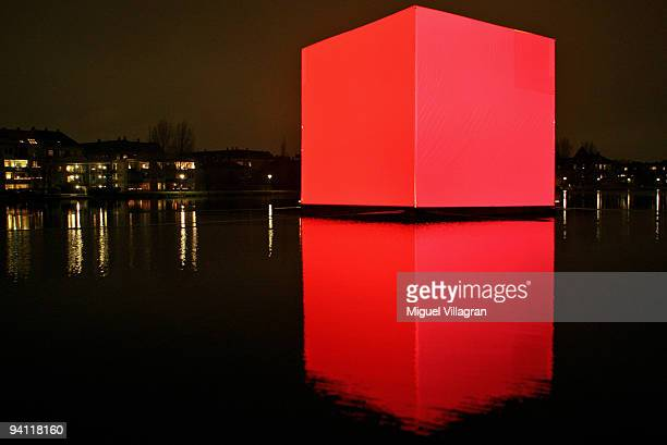 The socalled CO2 cube is reflected in a stretch of water next to the Tycho Brahe Planetarium on December 7 2009 in Copenhagen Denmark The CO2 cube...