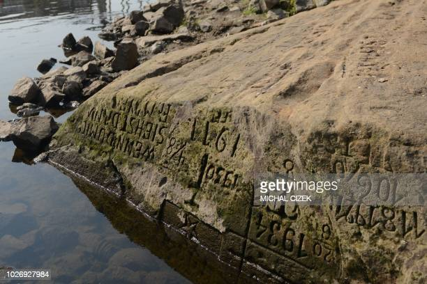 The socalled Hunger Stone is pictured in Decin Czech Republic on August 29 by the low water level of the Elbe river Once an ominous harbinger of low...
