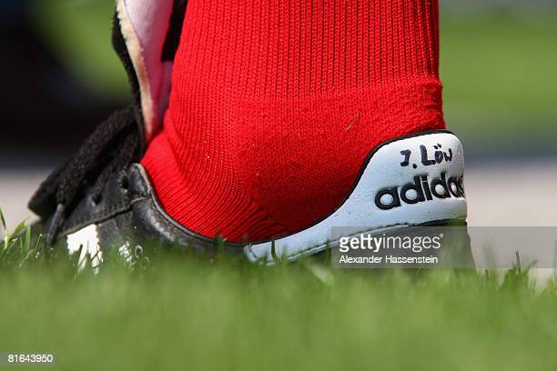 The soccer boots of Joachim Loew head coach of the German national team are seen during a training session at the Centro Sportivo Tenero on June 20...
