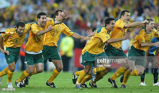 The Socceroos celebrate victory after the penalty shoot-out during the second leg of the 2006 FIFA World Cup qualifying match between Australia and...