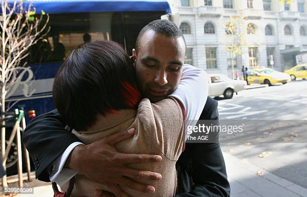The Socceroos leave The Grand Hyatt in Melbourne today to fly to Europe for The World Cup Pictured is Archie Thompson saying goodbye to his wife Emmy...