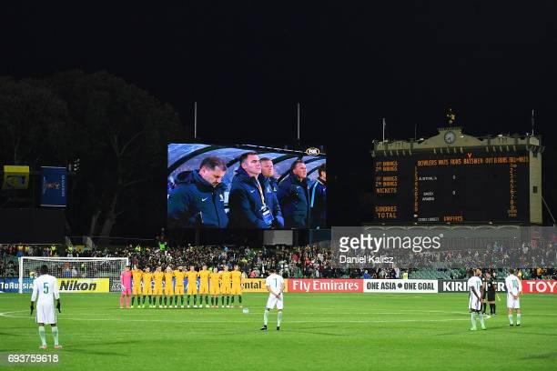 The Socceroos players observe a moments silence prior to the 2018 FIFA World Cup Qualifier match between the Australian Socceroos and Saudi Arabia at...