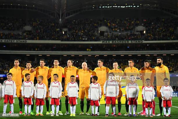 The Socceroos players sing the Australian national anthem prior to the 2018 FIFA World Cup Qualifier match between the Australian Socceroos and Saudi...
