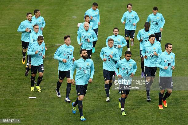 The Socceroos squad warm up during an Australian Socceroos training session at Leichhardt Oval on June 1 2016 in Sydney Australia