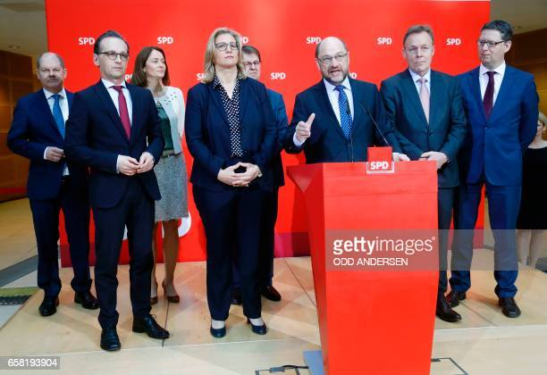 The Social Democrats Party party leader and candidate for Chancellery Martin Schulz addresses a press conference as Hamburg Mayor Olaf Scholz, German...