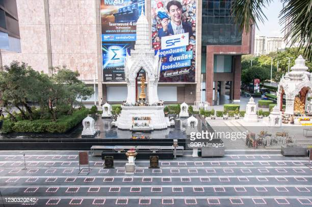 The Social distancing squares are seen in front of the Trimurti Shrine on Ratchadamri Road. The Thai government has applied social distancing...