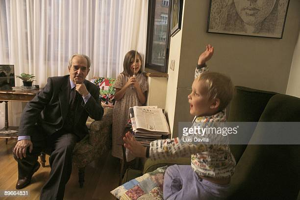 The socialist politician Fernando Moran in his house next to his grandsons