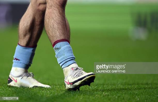 The socks and boots of Aston Villa's English midfielder Jack Grealish are seen during the English Premier League football match between West Bromwich...