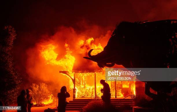 TOPSHOT The Soda Rock Winery burns during the Kincade fire as flames race through Healdsburg California on October 27 2019 Powerful winds were...