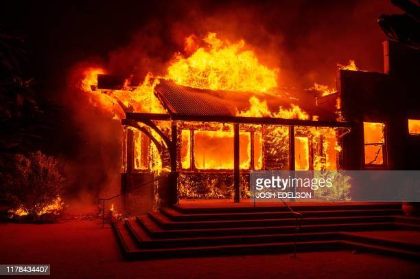 The Soda Rock Winery burns during the Kincade fire as flames race through Healdsburg California on October 27 2019 Powerful winds were fanning...