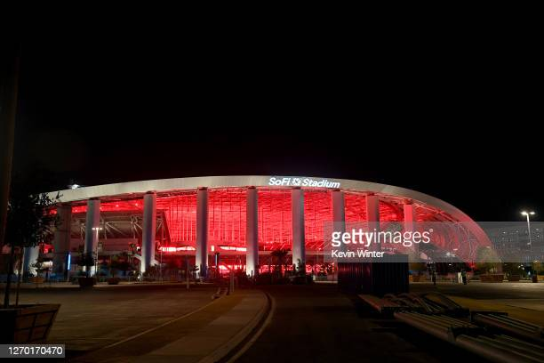 The SoFi Stadium is lit in red as venues nationwide participate in the Red Alert RESTART campaign to pressure Congress to provide financial help to...