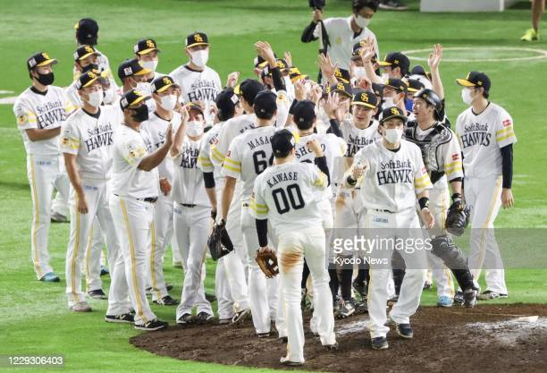 The SoftBank Hawks celebrate after clinching their first Pacific League title in three years with a 5-1 win over the Lotte Marines at PayPay Dome in...