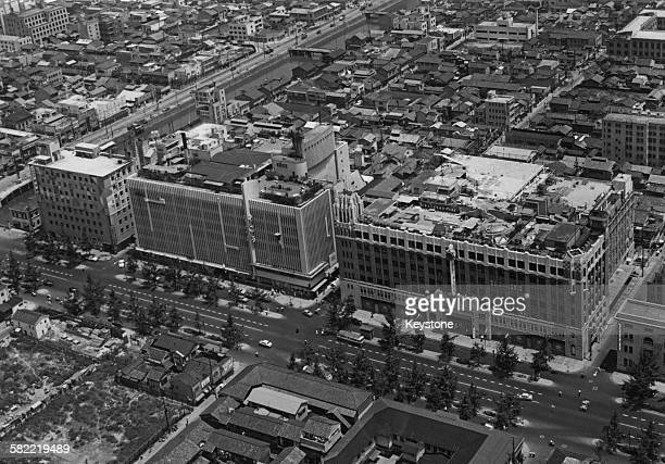 The Sogo department store and the Daimaru department store on the Midosuji Boulevard in Osaka Japan 1956