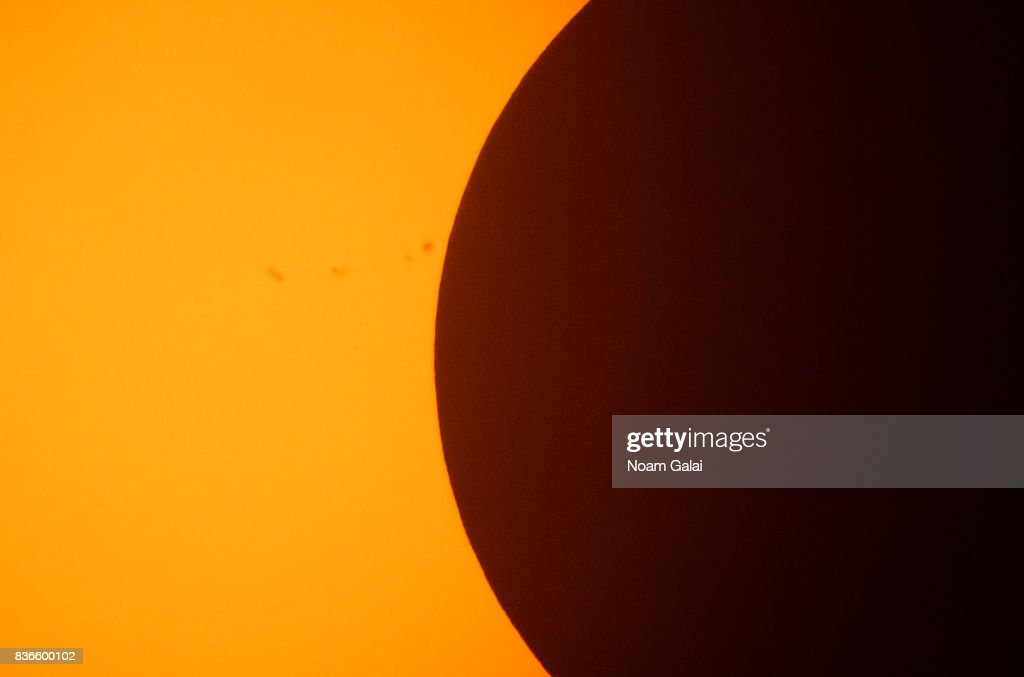 The solar eclipse is seen at Liberty Island on August 21, 2017 in New York City. While New York was not in the path of totality for the solar eclipse, around 72 percent of the sun was covered by the moon during the peak time of the partial eclipse.