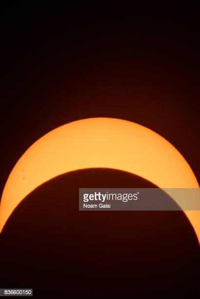 The solar eclipse is seen at Liberty Island on August 21 2017 in New York City While New York was not in the path of totality for the solar eclipse...