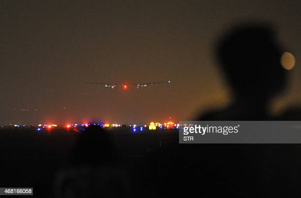 The Solar Impulse 2 comes in to land in Chongqing airport at 135 am after a 22andahalf hour flight from Myanmar on March 31 2015 Solar Impulse 2...