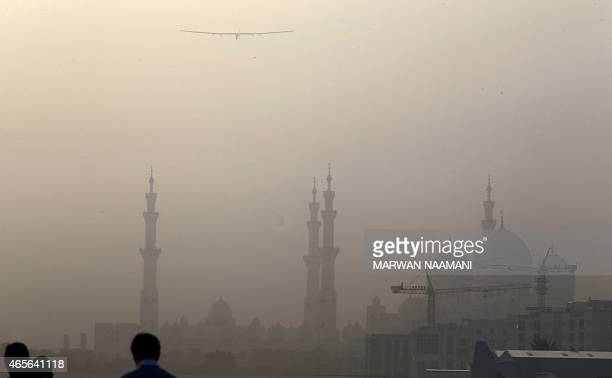 The Solar Impulse 2 flies over Sheikh Zayed mosque after taking off from alBateen airport in Abu Dhabi as it heads to Muscat on March 9 in the first...