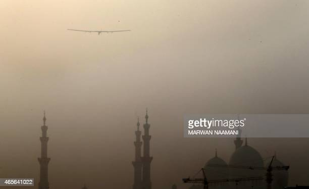 The Solar Impulse 2 piloted by Andre Borschberg of Switzerland flies over Sheikh Zayed mosque after taking off from alBateen airport in Abu Dhabi as...