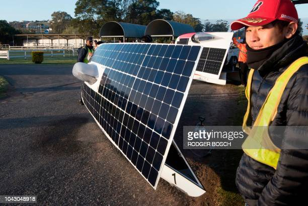 The solar panels of the competing cars are faced towards the sun before the start of the 8th and the final day of the Sasol Solar Challenge on...
